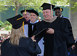 President Chester Burton gives out diplomas during the 2015 Western Nevada College Commencement held at the Pony Express Pavilion in Carson City, Nev., on Monday, May 18, 2015.<br /> Photo by Tim Dunn