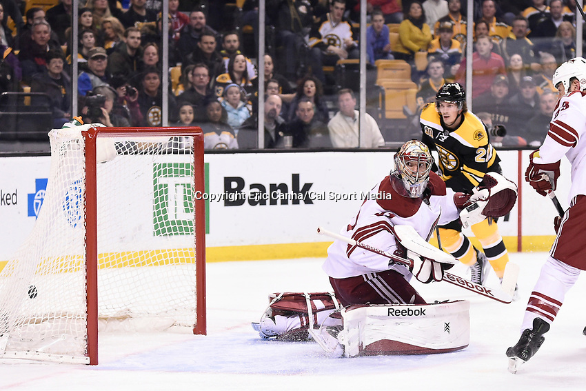 March 13, 2014 - Boston, Massachusetts , U.S. - Phoenix Coyotes goalie Mike Smith (41) looks back to find the puck in the net during the NHL game between the Phoenix Coyotes and the Boston Bruins held at TD Garden in Boston Massachusetts. Eric Canha/CSM