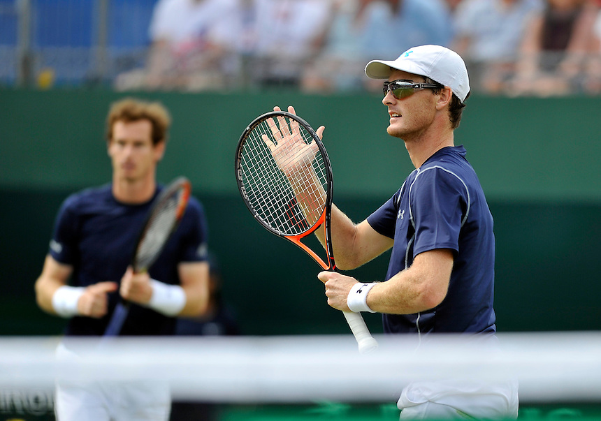 Jamie Murray in action with partner Andy Murray against Jo-Wilfried Tsonga and Nicolas Mahut in their doubles match today<br /> <br /> Photographer Ashley Western/CameraSport<br /> <br /> International Tennis - 2015 Davis Cup by BNP Paribas - World Group Quarterfinals - Great Britain v France - Day 2 - Saturday 18th July 2015 - Queens Club - London<br /> <br /> &copy; CameraSport - 43 Linden Ave. Countesthorpe. Leicester. England. LE8 5PG - Tel: +44 (0) 116 277 4147 - admin@camerasport.com - www.camerasport.com.