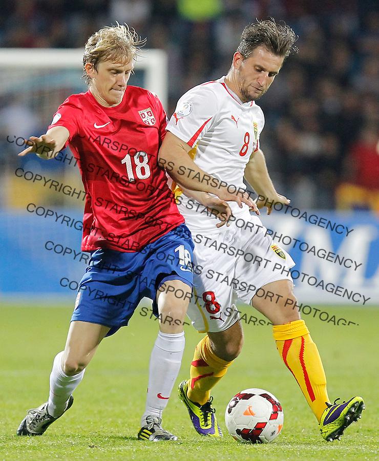 Fudbal Soccer<br /> World Cup 2014 qualifiers match<br /> Serbia v Macedonia<br /> Dusan Basta (L) and Muhamed Demiri (R)<br /> Jagodina, 15.10.2013.<br /> foto: Srdjan Stevanovic/Starsportphoto &copy;