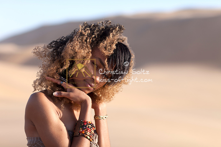 Simona, a young Nama woman, in the dunes near Swakopmund. She is a modern Namibian citizen and does not know much about the history of her ancestors.