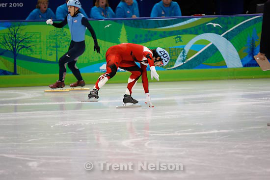 Trent Nelson  |  The Salt Lake Tribune.Men's 500m final, Short Track Speed Skating at the Pacific Coliseum Vancouver, XXI Olympic Winter Games, Friday, February 26, 2010. Charles Hamelin (205, Canada, gold medal), Sung Si-Bak (244, Korea, silver medal), Francois-Louis Tremblay (208, Canada, bronze medal), Apolo Anton Ohno (256, USA, disqualified)