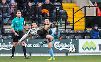Curtis Thompson of Notts County & Michael Harriman of Wycombe Wanderers go for the ball during the Sky Bet League 2 match between Notts County and Wycombe Wanderers at Meadow Lane, Nottingham, England on 28 March 2016. Photo by Andy Rowland.