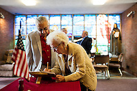 "Tom and Joanmarie Gorman, of Scituate, Mass., write in a notebook before the final service at St. Frances Xavier Cabrini Church in Scituate, Mass., on Sun., May 29, 2016. The couple has attended the church for 48 years. Members of the congregation have been holding a vigil for more than 11 years after the Archdiocese of Boston ordered the parish closed in 2004. For 4234 days, at least one member of Friends of St. Frances X. Cabrini has been at the church at all times, preventing the closure of the church. May 29, 2016, was the last service held at the church after members finally agreed to leave the building after the US Supreme Court decided not to hear their appeal to earlier an Massachusetts court ruling stating that they must leave. The last service was called a ""transitional mass"" and was the first sanctioned mass performed at the church since the vigil began."