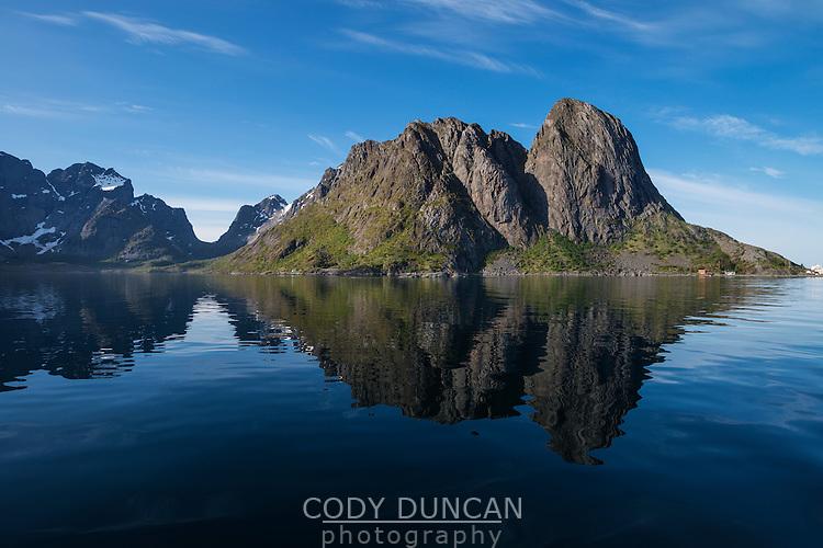 Mountain reflection in Reinefjord, near Reine, Moskenesøy, Lofoten Islands, Norway
