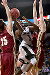 SIOUX FALLS, SD - MARCH 6:  Devin Patterson #3 of Omaha attempts a shot against defenders Marcus Byrd #34 and Thomas Neff #15 of Denver in the 2016 Summit League Tournament. (Photo by Dave Eggen/Inertia)