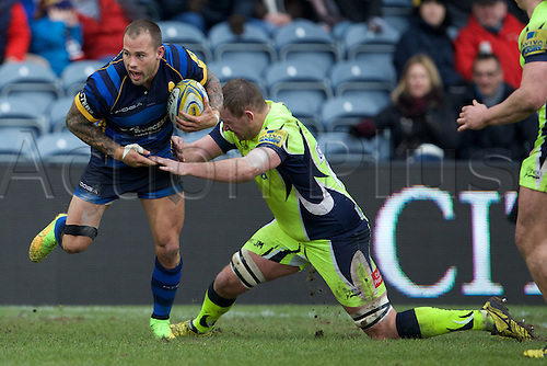 20.02.2016. Sixways Stadium, Worcester, England. Aviva Premiership. Worcester Warriors versus Sale Sharks. Worcester Warriors scrum-half Francois Hougaard with the ball is tackled by Sale Sharks lock Jonathan Mills.
