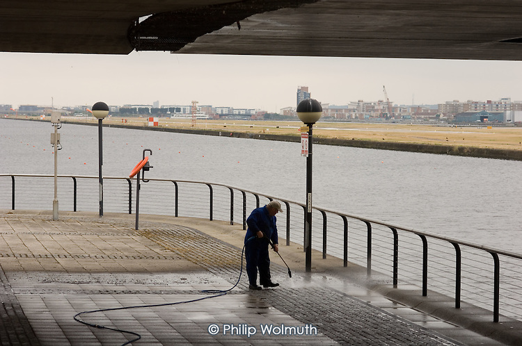 A Royal Docks worker does maintenance work at Royal Albert Dock, which will be used for the London 2012 Olympic Games.