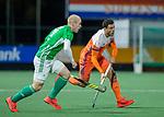 AMSTELVEEN - Glenn Schuurman (Ned) met Eugene Magee (IRE)  heeft gescoord  tijdens de hockeyinterland Nederland-Ierland (7-1) , naar aanloop van het WK hockey in India.  COPYRIGHT KOEN SUYK