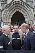 John McDonnell MP and Roy Bentham, Blacklist Support Group celebrate outside the Royal Courts of Justice after victory in their campaign for compensation for  illegal blacklisting of construction workers.