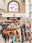 Sears store at Toronto Eaton Centre shopping mall full of people on Boxing day in 2011. Toronto, Ontario, Canada.