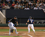 Reno Aces' Nick Ahmed scores against Las Vegas 51s' Logan Verrett, in Reno, Nev., on Saturday, Sept. 6, 2014. The Aces won 7-3, to win the Pacific Conference Championship Series. <br /> Photo by Cathleen Allison
