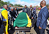 Qunu, South Africa: 14.12.2013: NELSON MANDELA BODY RETURNS TO QUNU<br /> ANC Leadership led by Deputy President Cyril Ramaphosa, National Chairperson Baleka Mbete, Secretary General Gwede Mantashe, Minister Siyabonga Cwele, Minister Nathi Mthethwa, Minister Collins Chabane, Minister Jeff Radebe and Treasurer General Dr Zweli Mkhize were pallbearers as they took over from the Army, while Nelson's grandson Mandla Mandela looks on.<br /> The casket is draped in the ANC Flag.<br /> The former President of South Africa Nelson Mandela will be buried in a private ceremony on Sunday 15th December 2013 in Qunu.<br /> Mandatory Credit Photo: &copy;Jiyane-GCIS/NEWSPIX INTERNATIONAL<br /> <br /> **ALL FEES PAYABLE TO: &quot;NEWSPIX INTERNATIONAL&quot;**<br /> <br /> IMMEDIATE CONFIRMATION OF USAGE REQUIRED:<br /> Newspix International, 31 Chinnery Hill, Bishop's Stortford, ENGLAND CM23 3PS<br /> Tel:+441279 324672  ; Fax: +441279656877<br /> Mobile:  07775681153<br /> e-mail: info@newspixinternational.co.uk