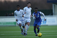 Ade Cole of Grays and Johnathan Nzengo of Romford during Grays Athletic vs Romford, Bostik League Division 1 North Football at Parkside on 1st January 2018