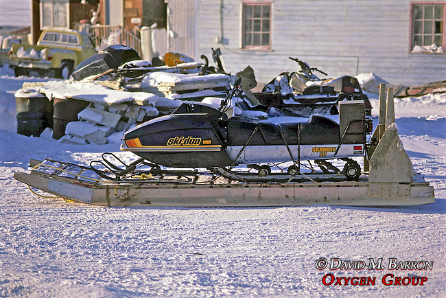 Snowmobile On Traditional Sled