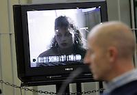 L'imputato Raniero Busco assiste alla proiezione di un'intervista a Paola Cesaroni, sorella della sua ex fidanzata Simonetta, durante l'udienza per il delitto di Simonetta, presso l'aula bunker di Rebibbia, Roma, 16 febbraio 2010..UPDATE IMAGES PRESS/Riccardo De Luca