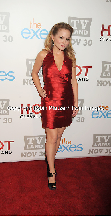 """Kelly Stables in red BeBe dress attends the TV Land Party for the  premieres of """"Hot In Cleveland"""" and """"The Exes""""  on November 29, 2011 at SD26 in New York City. the party also celebrated Toys for Tots."""