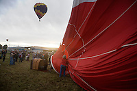 After a light rain started, balloon owners decided not go into the air at the Great Prosser Balloon Rally in Prosser, Washington, USA.  The balloons, which cost as much as $50,000, can be ruined if put away wet.