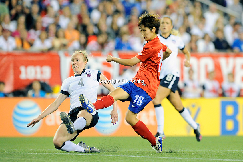 Korea Republic forward Kim Sanguen (16) and US Women's National defender Becky Sauerbrunn (4) in action during the International Friendly soccer match between the USA Women's National team and the Korea Republic Women's Team held at Gillette Stadium in Foxborough Massachusetts.   Eric Canha/CSM