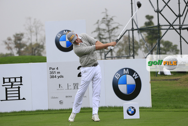 Marcel Siem (GER) tees off the 2nd tee during Saturay's Round 3 of the 2014 BMW Masters held at Lake Malaren, Shanghai, China. 1st November 2014.<br /> Picture: Eoin Clarke www.golffile.ie