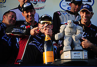 Sept. 20, 2008; Dover, DE, USA; Nascar Nationwide Series driver Kyle Busch attempts to use a screw driver to open a bottle of champagne after the cork broke as he attempted to open it in victory lane after winning the Camping World RV 200 at Dover International Speedway. Mandatory Credit: Mark J. Rebilas-