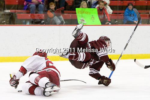 Matt McCollem (Harvard - 23), Brian Day (Colgate - 12) - The Harvard University Crimson defeated the visiting Colgate University Raiders 6-2 (2 EN) on Friday, January 28, 2011, at Bright Hockey Center in Cambridge, Massachusetts.