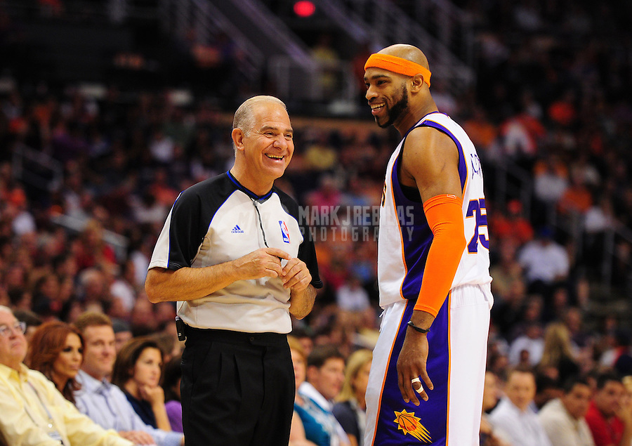Apr. 13, 2011; Phoenix, AZ, USA; Phoenix Suns guard (25) Vince Carter with NBA referee Bennett Salvatore against the San Antonio Spurs at the US Airways Center. Mandatory Credit: Mark J. Rebilas-