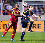 Real Salt Lake defender Jamison Olave (4) and Philadelphia Union forward Fernando Aristeguieta (18) vie for the ball in the second half Saturday, March 14, 2015, during the Major League Soccer game at Rio Tiinto Stadium in Sandy, Utah. (© 2015 Douglas C. Pizac)
