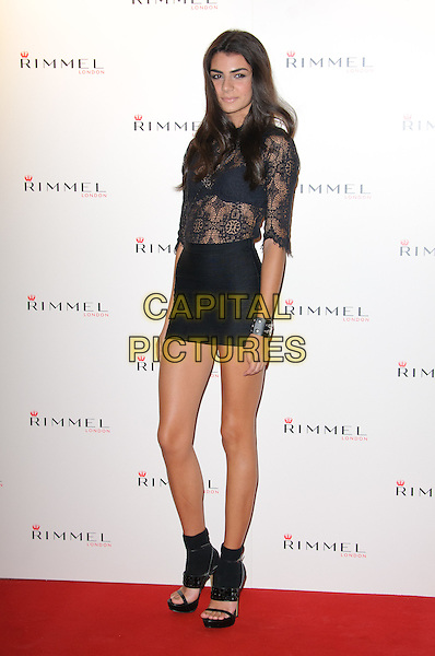 Alejandra Ramos.The Rimmel London party, Battersea Power Station, London, England..September 15th, 2011.full length black skirt lace top see through thru bra open toe sandals shoes .CAP/CJ.©Chris Joseph/Capital Pictures.