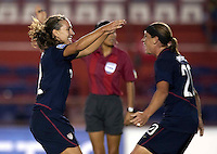 Lauren Cheney (left) and Abby Wambach (right) celebrate. USWNT vs Costa Rica in the 2010 CONCACAF Women's World Cup Qualifying tournament held at Estadio Quintana Roo in Cancun, Mexico on November 8th, 2010.