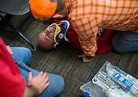NWA Democrat-Gazette/CHARLIE KAIJO Shane Schulze of Siloam Springs portrays a patient as students practice a medical emergency scenario on him on Thursday, October 12, 2017 at Northwest Arkansas Community College in Bentonville.  NWACC is working to increase its enrollment in paramedic studies to help meet the increasing need for paramedics in the region.