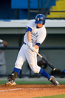 Geoff Baldwin #26 of the Burlington Royals connects with the baseball against the Greeneville Astros at Burlington Athletic Stadium June22, 2010, in Burlington, North Carolina.  Photo by Brian Westerholt / Four Seam Images