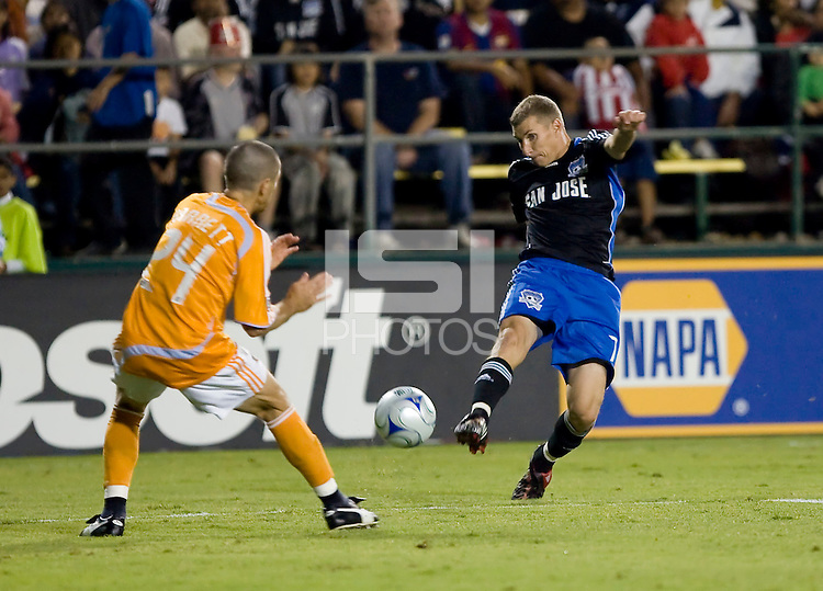 Ronnie O'Brien (7) kicks the ball against Dynamo's Wade Barrett (24) for the goal in the 50th minute.San Jose Earthquakes tied Houston Dynamo 1-1 at Buck Shaw Stadium in Santa Clara, California. September 13, 2008.