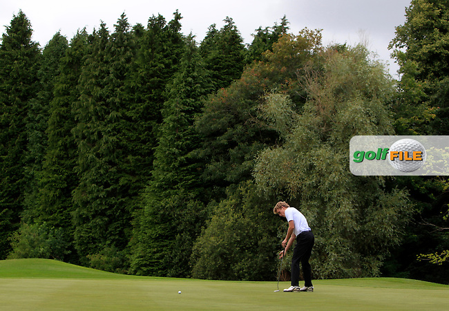 Hugh O'Hare (Fortwilliam) on the 16th green during Round 1 of the Ulster Youths Championship at Belvoir Golf Club on Tuesday 4th August 2015.<br /> Picture:  Thos Caffrey / www.golffile.ie
