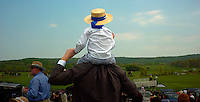 Jerry Gibbs sits on his father Dwight's shoulders to watch a horse race at the 80th Virginia Gold Cup May 7, 2005 at Great Meadow in The Plains, VA.