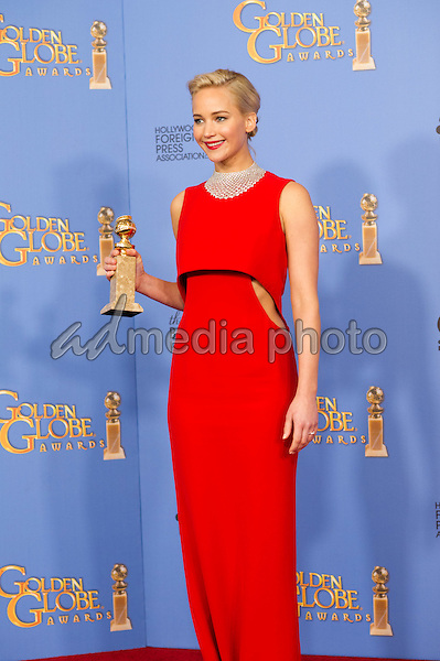 """After winning the category of BEST PERFORMANCE BY AN ACTRESS IN A MOTION PICTURE – COMEDY OR MUSICAL for her work in """"Joy,"""" actress Jennifer Lawrence poses backstage in the press room with her Golden Globe Award at the 73rd Annual Golden Globe Awards at the Beverly Hilton in Beverly Hills, CA on Sunday, January 10, 2016. Photo Credit: HFPA/AdMedia"""