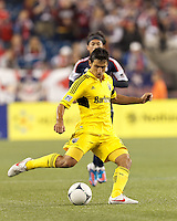 Columbus Crew midfielder Milovan Mirosevic (10) passes the ball. In a Major League Soccer (MLS) match, the New England Revolution tied the Columbus Crew, 0-0, at Gillette Stadium on June 16, 2012.