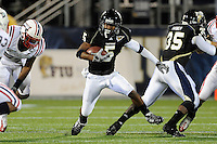 5 December 2009:  FIU wide receiver Wayne Times (5) breaks into the secondary in the second half as the Florida Atlantic University Owls defeated the FIU Golden Panthers, 28-21, in the annual Shula Bowl game at FIU Stadium in Miami, Florida.