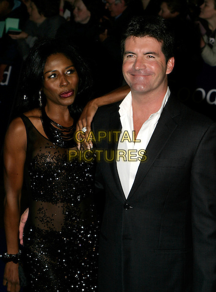 SINITTA & SIMON COWELL.National Television Awards 2005 at the Royal Albert Hall, SW7, London, UK..October 25th, 2005.Ref: AH.half length arm on shoulder black sheer sequins.www.capitalpictures.com.sales@capitalpictures.com.© Capital Pictures.