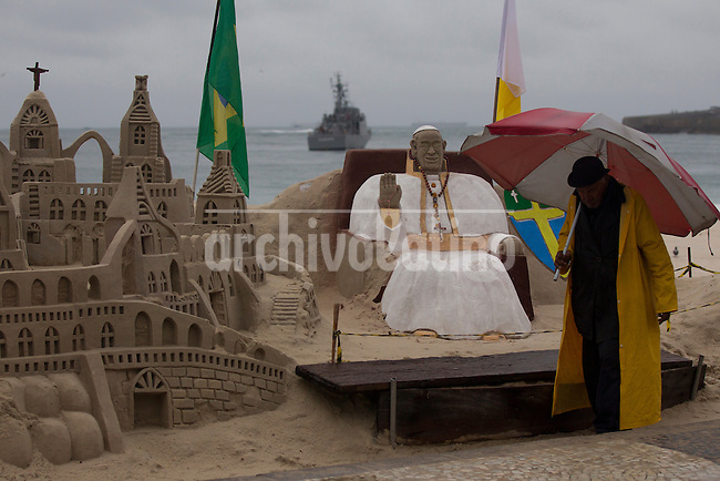 Pope Francis during a mass in Copacabana beach, Rio de Janeiro, Brazil<br /> A Pope figure sculpted on the sand