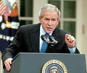Washington, D.C. - October 11, 2006 -- United States President George W. Bush conducts a press conference in the Rose Garden at the White House in Washington, D.C. on Wednesday, October 11, 2006.  The President was asked questions on the economy, Iraq, North Korea's nuclear test, and the Foley scandal.<br /> Credit: Ron Sachs / CNP