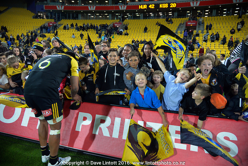 Vaea Fifita signs autographs after the Super Rugby match between the Hurricanes and Southern Kings at Westpac Stadium, Wellington, New Zealand on Friday, 25 March 2016. Photo: Dave Lintott / lintottphoto.co.nz