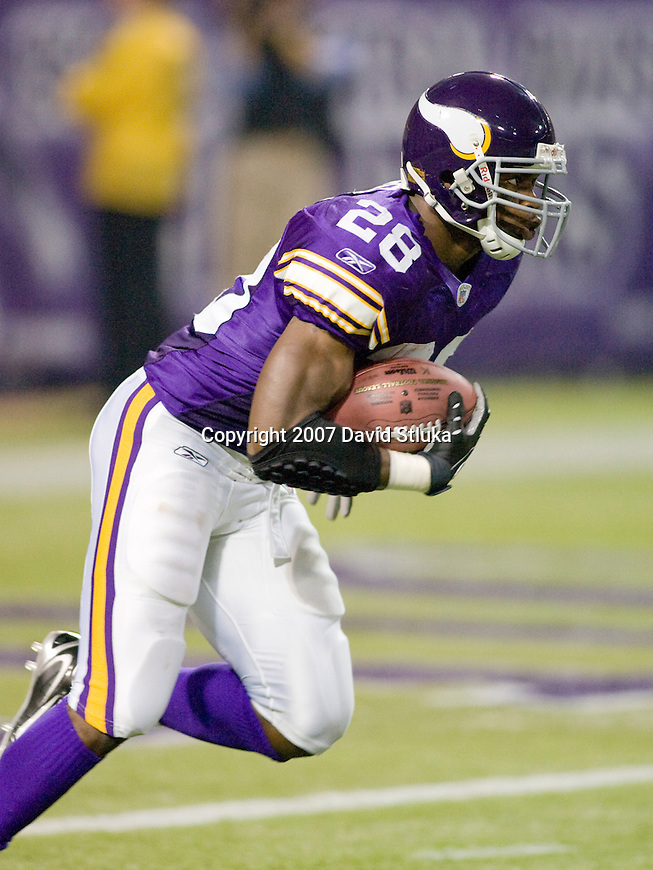 Running back Adrian Peterson #28 of the Minnesota Vikings returns a kick during an NFL football game against the Green Bay Packers at Hubert H. Humphrey Metrodome on September 30, 2007 in Minneapolis, Minnesota. The Packers beat the Vikings 23-16. (Photo by David Stluka)