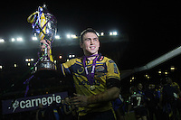 PICTURE BY VAUGHN RIDLEY/SWPIX.COM - Rugby League - Carnegie World Club Challenge - Leeds Rhinos v Melbourne Storm - Elland Road, Leeds, England - 29/02/08...Copyright - Simon Wilkinson - 07811267706..Leeds Kevin Sinfield is doused with champagne as he lifts the cup.