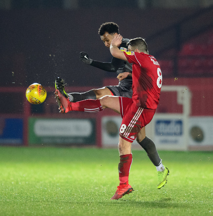 Lincoln City's Matt Green vies for possession with Accrington Stanley's Scott Brown<br /> <br /> Photographer Andrew Vaughan/CameraSport<br /> <br /> The EFL Checkatrade Trophy Second Round - Accrington Stanley v Lincoln City - Crown Ground - Accrington<br />  <br /> World Copyright © 2018 CameraSport. All rights reserved. 43 Linden Ave. Countesthorpe. Leicester. England. LE8 5PG - Tel: +44 (0) 116 277 4147 - admin@camerasport.com - www.camerasport.com