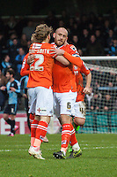 Craig Mackail-Smith of Luton Town and Scott Cuthbert of Luton Town celebrate the opening goal during the Sky Bet League 2 match between Wycombe Wanderers and Luton Town at Adams Park, High Wycombe, England on 6 February 2016. Photo by Claudia Nako.