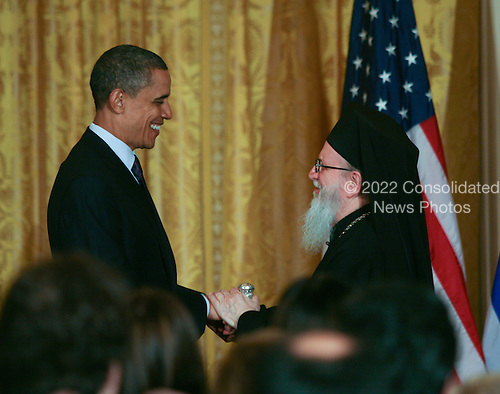 United States President Barack Obama hosted a reception in The East Room of the White House in honor of Greek Independence Day on Friday, March 25, 2011.  The President stood with Archbishop Demetrios of America, Primate of the Greek Orthodox Church in America..Credit: Gary Fabiano / Pool via CNP