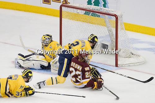Mac Bennett (Michigan - 37), Shawn Hunwick (Michigan - 31), Greg Pateryn (Michigan - 2), J.T. Brown (Duluth - 23) - The University of Minnesota-Duluth Bulldogs defeated the University of Michigan Wolverines 3-2 (OT) to win the 2011 D1 National Championship on Saturday, April 9, 2011, at the Xcel Energy Center in St. Paul, Minnesota.