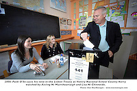 Former Kerry footballer and trainer Paidi O'Se casts his vote in the Lisbon Treaty at Ventry national School County Kerry on Thursday watched by Aisling Ni Muircheartaigh and Lisa Ni Chinneide..Picture by Don MacMonagle