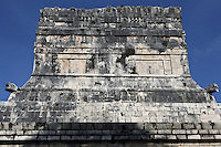Upper frieze of the Temple of the Jaguars, southern end of the east platform of the court of the Game of Ball, 900-1100 AD, Toltec Architecture, Chichen Itza, Yucatan, Mexico. There are eight jaguars on each of the four sides of the temple, a total of thirty two, of which sixteen are facing one way and sixteen the other. Every two jaguars represents animal strength. There is a circle containing sixteen dots which the animals are trying to break so as to keep the adept in a state of ignorance and unawareness. There is a bas-relief depicting a serpent with a head on each side. The temple was also used as the grandstand for the more important spectators. Picture by Manuel Cohen